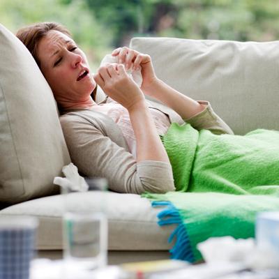 woman-sofa-sick