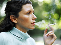 woman smoking blue sweater 200x150 Pack a Day Smokers Declining