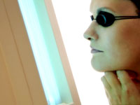 woman tanning face 200 Study: Frequent Tanning Bed Use Triples Melanoma Risk