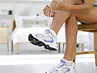 day 18 knotting white sneakers 200x150 How Many Pairs of Fitness Shoes Do You Really Need?