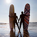 surfing-couple-handholding