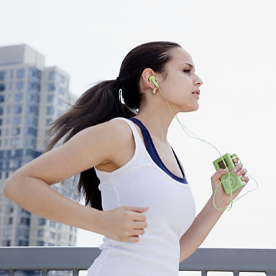 woman running music 400x400 How To Tighten And Shape Your Body