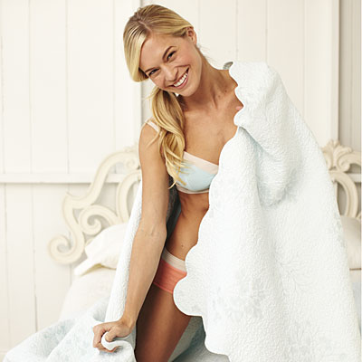 woman-smiling-blanket