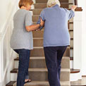 women-stairs-senior-care-relative