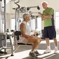 senior-men-lifting-weights-in-gym
