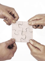 four-hands-puzzle-pieces-together