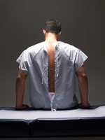 man-patient-physical-gown-hpv