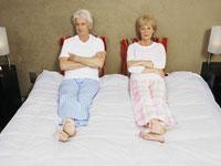 senior-couple-bed-unhappy