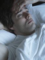 man-awake-bed-stress