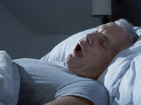 man-sleep-apnea-snoring