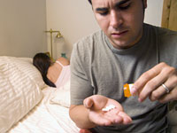 man-sleeping-pills-addiction