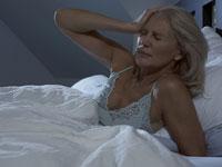 woman-bed-pain-sleep