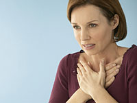 chest-pain-woman-hands