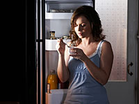 fridge night yogurt 200x150 Why Nighttime Calories Are Worse for Your Waist