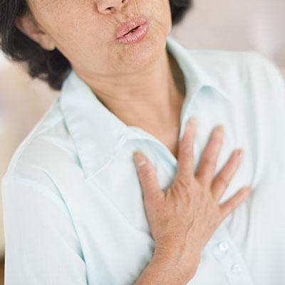 heart-burn-woman-pain