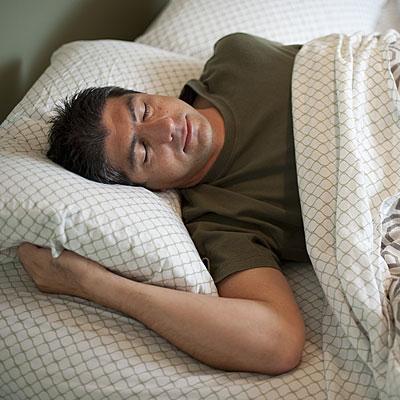 man-sleeping-bed