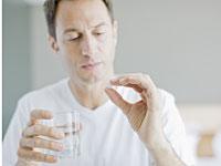 man-taking-pill