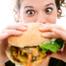 woman-eating-burger