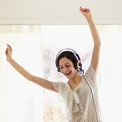 woman-headphones-dancing-