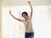 woman-headphones-dancing-