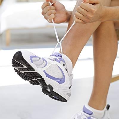 woman-lacing-shoes
