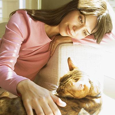 woman-petting-cat