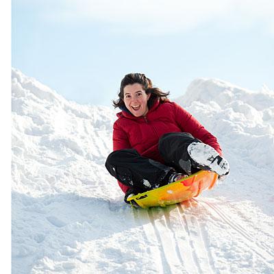 woman-sledding-park