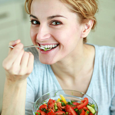 woman-smiling-eating-salad
