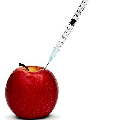 syringe in apple