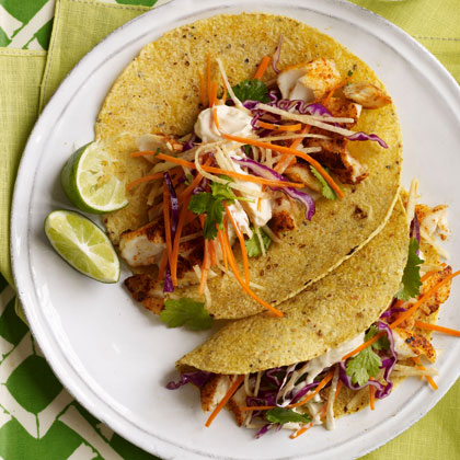 Fish tacos with cabbage carrot slaw and spicy crema recipe for Slaw recipe for fish tacos
