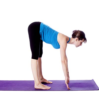 Wide legged standing forward bend or ardha uttanasana for Floor yoga stretches
