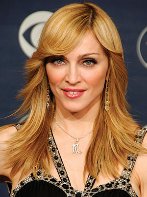 "The image ""http://img2.timeinc.net/instyle/images/2007/galleries/070607_madonna_300X400.jpg"" cannot be displayed, because it contains errors."