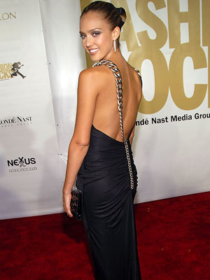 star Jessica Alba showed off her sexy back—and a delicate neck tattoo—in