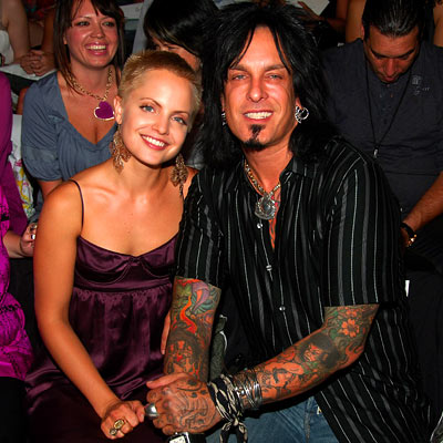 Mena Suvari showed off her buzz-cut and rocker Nikki Sixx showed off his