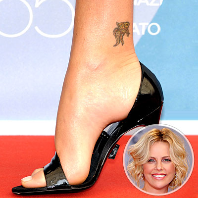 fish tattoo designs on Charlize Theron - Celebrity Tattoos Revealed - Get Star Style ...