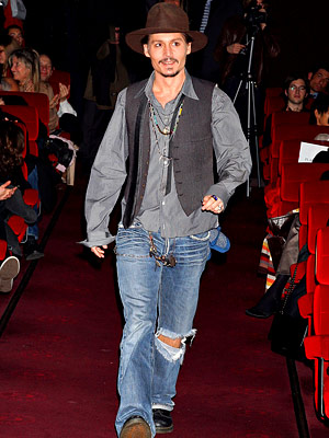 Depp told reporters that he was at home in France when he received news of