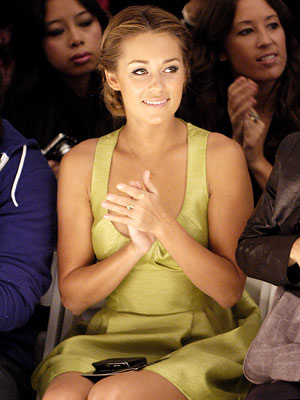 Lauren Conrad showed off her perfect posture and elegant updo in the front