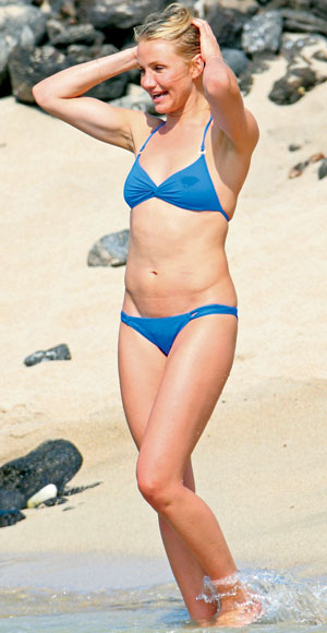 With her slim body and Light blond hairtype without bra (cup size 34B) on the beach in bikini