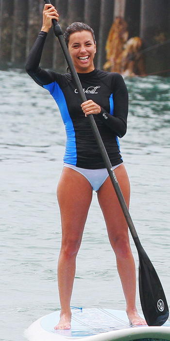 Eva Longoria in mix and match swim gear