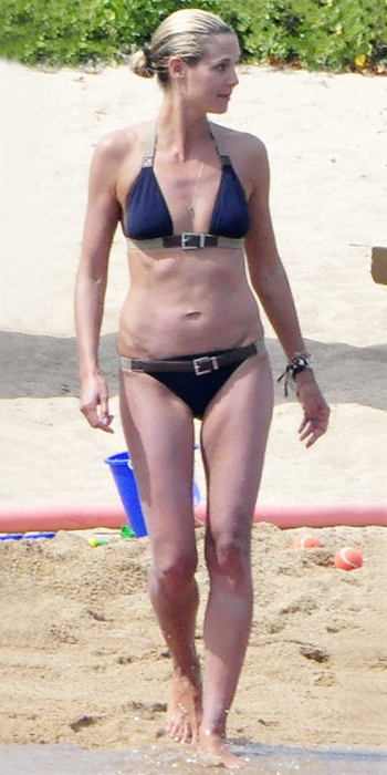 Heidi Klum in a belted swimsuit