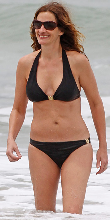 Julia Roberts in a black halter top bikini