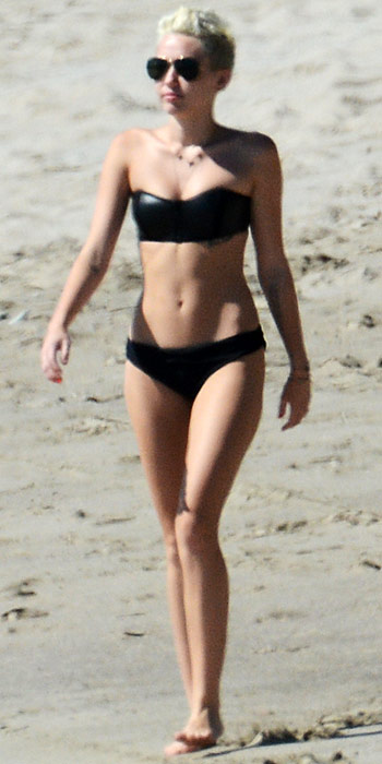 Miley Cyrus in a strapless swimsuit