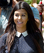 Kourtney Kardashian in Ann Taylor