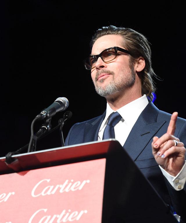 Brad Pitt wears a rainbow manicure.