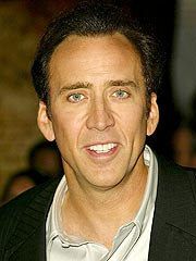 Cage Keeps Movie Crown Away from Colin