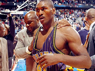Players, Fans Charged in Basket-Brawl Case   Ron Artest
