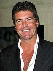 Simon Cowell Splits with Girlfriend
