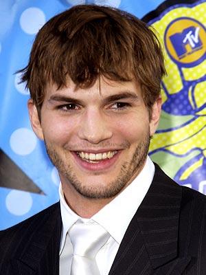 TIED UP photo | Ashton Kutcher