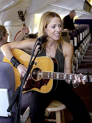 IN-FLIGHT ENTERTAINER  photo | Sheryl Crow
