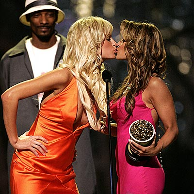 KISSING UP photo | Carmen Electra, Paris Hilton